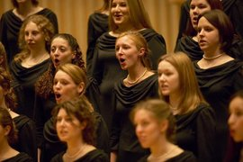 Students perform at a choral concert.