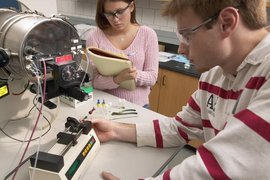 Students perform experiments with a biomolecular mass analyzer.
