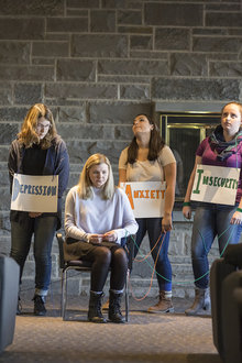 Students portray the struggle with mental illness on college campuses. Photo by Adam Baker