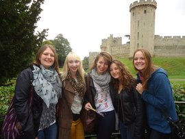 Students posing outside Warwick Castle