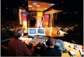 Students prepare lighting for a production.