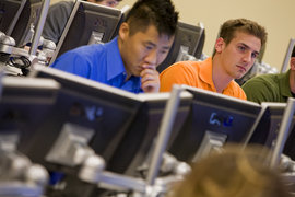 Students taking an international finance class in Ithaca's new Center for Trading and Analysis of Financial Instruments