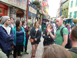 Students tour Shop Street in Galway, Ireland.