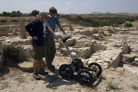 Students use a ground-penetrating radar system to investigate an archaeological site in Cyprus.