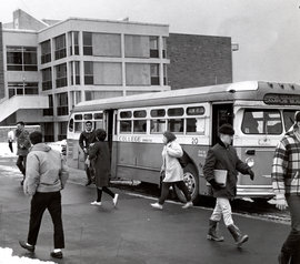 Students use the IC shuttle bus to get to campus in this 1965 photo from the Ithaca College archive.