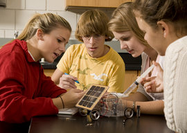 Students working with solar panels in an environmental science lab