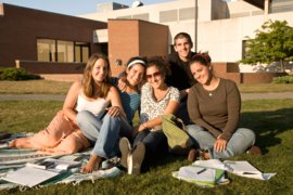 Summer Students study on the lawn of the campus.
