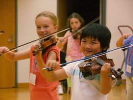 Suzuki students practicing a new piece