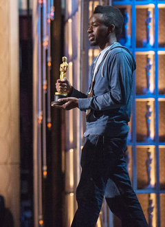 Tatenda Mbudzi '10 carries an Oscar during a rehearsal for the 85th Academy Awards in Los Angeles.