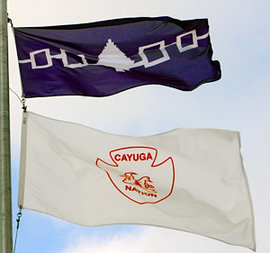 The Haudenosaunee and Cayuga Nation flags fly outside the Campus Center in November.