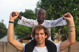 The author in Jambanjelly, Gambia, with a local boy