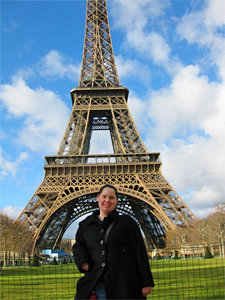 The author poses in front of the Eiffel Tower. Photo courtesy of Caylena Cahill '10