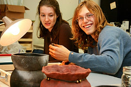 The author (right) and fellow anthropology major Rebecca Grollman '10 work to identify a piece of pottery. Pho