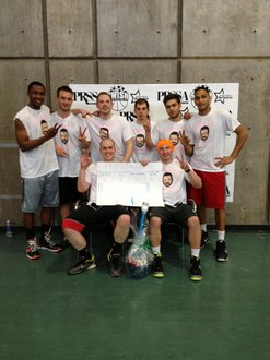 The wining team members of the Pro bracket, 99 Problems But a Pitch Ain't One, pose with their winning basket.