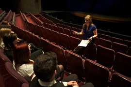 Theatre Arts Management students meet in a theatre before a show.