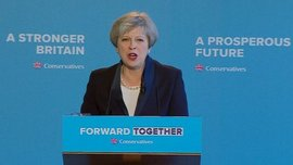 Theresa May with the 2017 Conservative Party Slogan (Photo: BBC News)