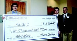Third place check presentation for last year's High School Investment competition. Photo by Carley Thomas '17