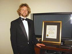 Travis Knapp '07 poses with his BMI award.