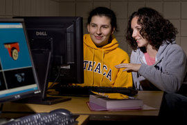 Two computer science students collaborate on a project.