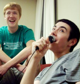 Two students, one with microphone