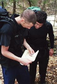 Two students reading a map