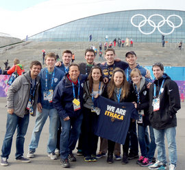 photo of students and alum at the Olympics