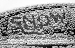 snowing car window with word snow