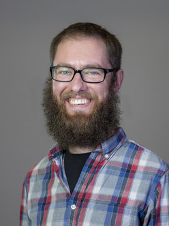 A bearded man with glasses