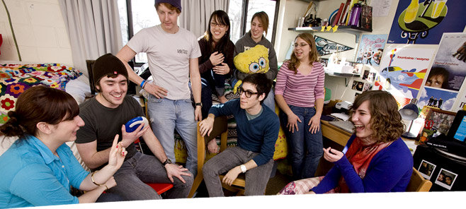 Office of Residential Life: Students hang out in a dorm room