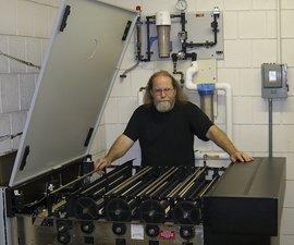 Tom Inman with a Kreonite print processor