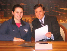 Annie on set with NBC Sports commentator Bob Costas.